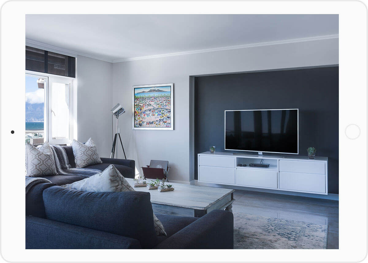 IoT smart home: Image of a gray and white living room